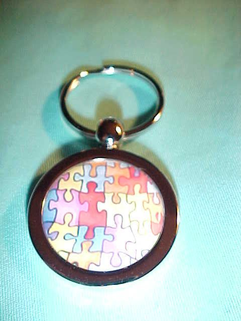 Autism puzzle pieces on shiny metal Keychain NEW